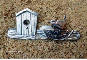 Brosche mit Vogel aus Quarter farthing